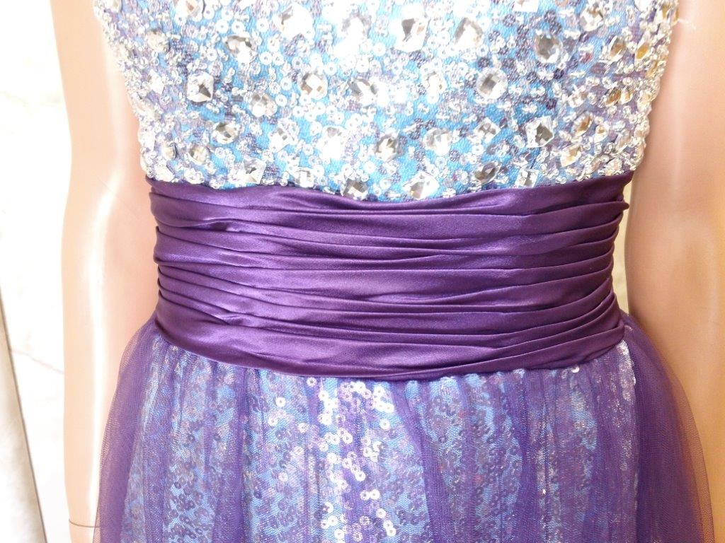 purple ruched waistline on sequin prom dress