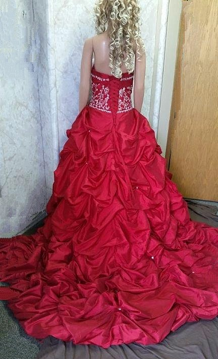 red wedding gown with pick up train