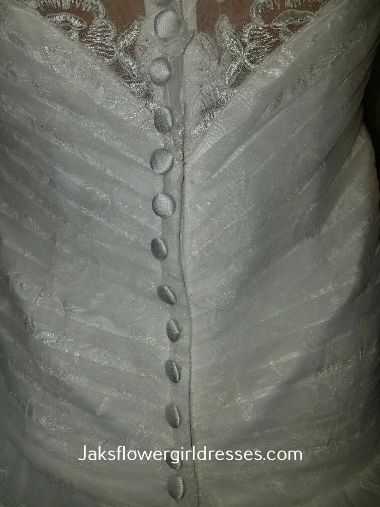 covered buttons over zipper