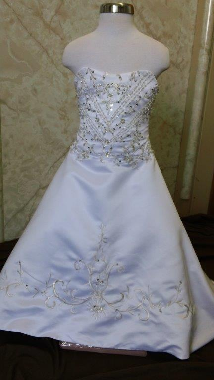 Strapless flower girl dress with embroidered long train