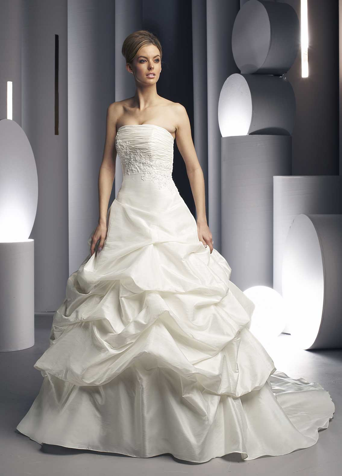 Wedding gown with pleated bust-line