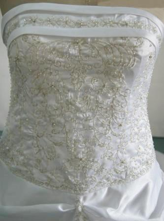 White strapless Bodice is banded with beaded embroidery