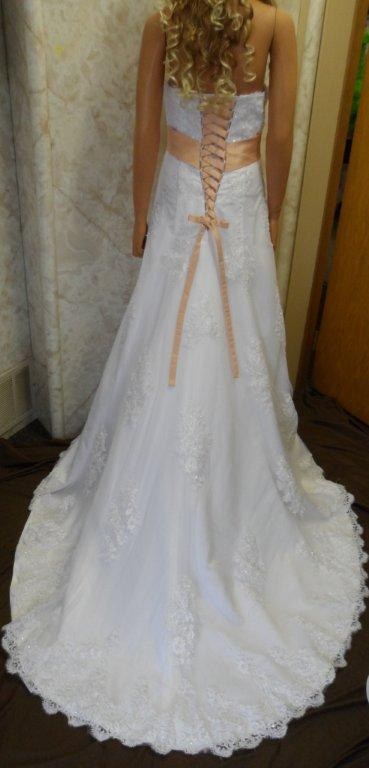 Strapless wedding gown with peach sash and matching corset ties