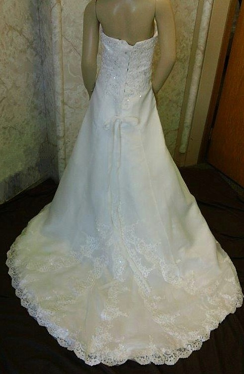 Beaded lace side drape with satin split front gown