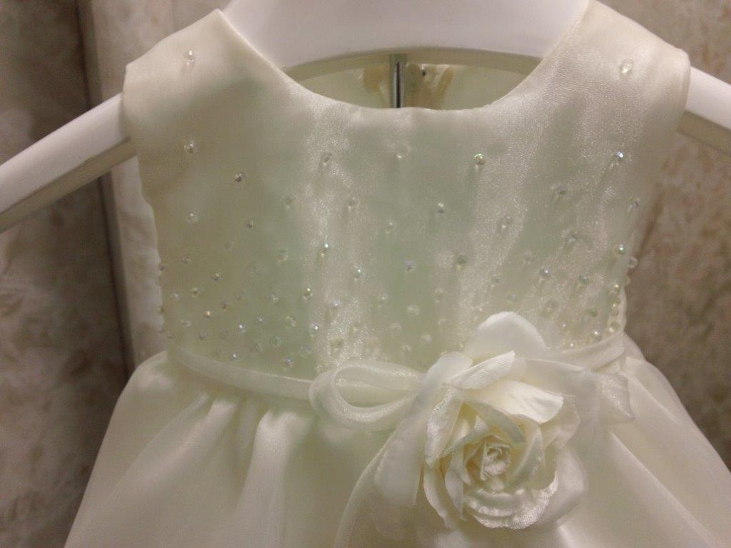 Sleeveless beaded bodice Baby dress with flower