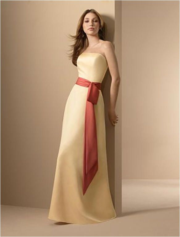 Yellow bridesmaid dresses with orange sash