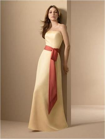 Yellow strapless bridesmaid dress with orange sash