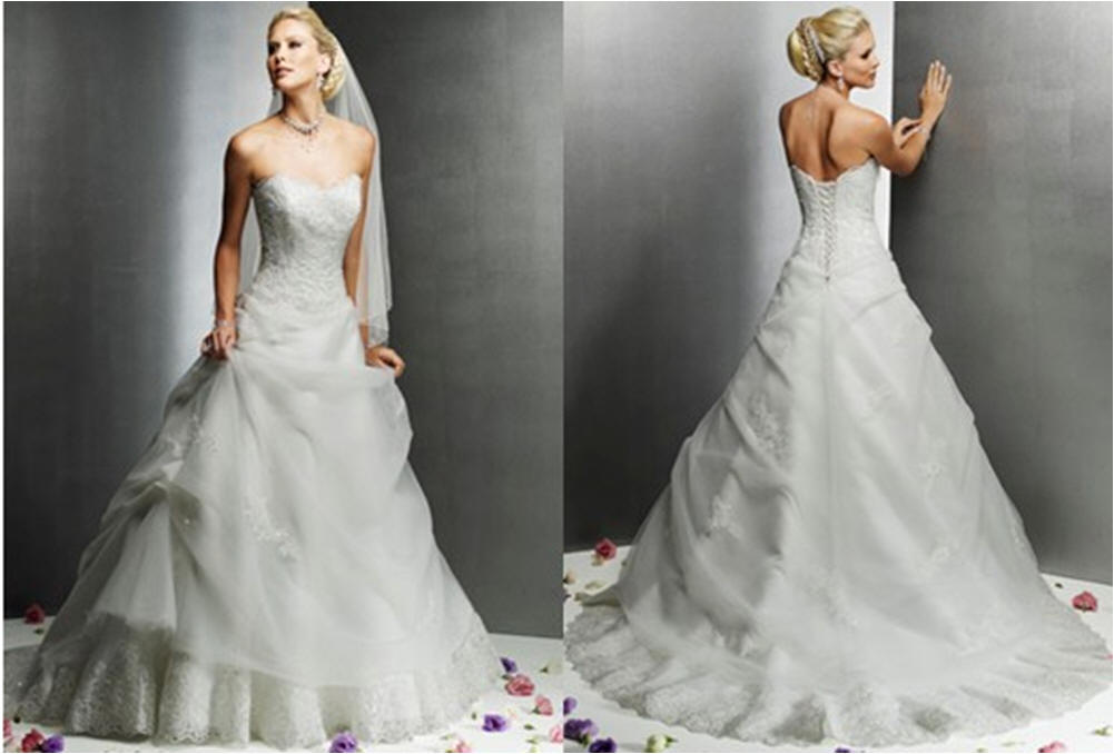 Sheer applique and lace enhance this strapless wedding gown