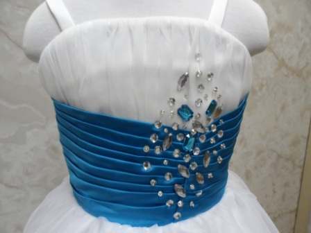 dress is dazzled with blue and silver jewels