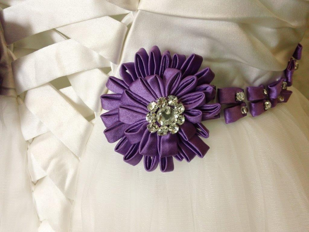 purple beaded hand rolled flowers