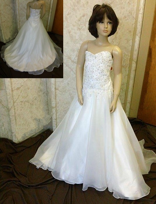 Flower girls dress to match the brides beaded wedding dress with lace