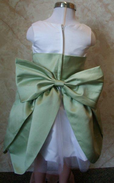 white and sage green toddler dress with large bow in the back