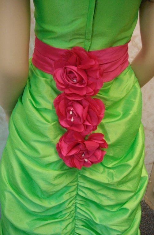 lime dress with hot pink sash and flowers