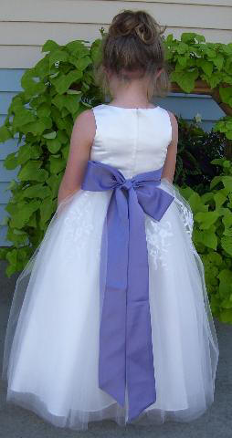long white flower girl dress with violet sash