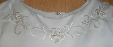 sleeves, embroidery and wider ribbons and bows