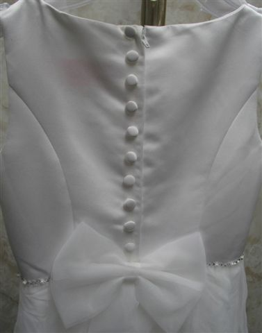 white dress with covered buttons