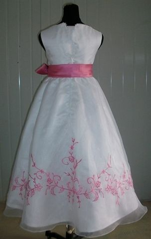 White girls dress with bubble gum pink trim and sash
