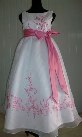 White custom dress with bubble gum pink trim and sash