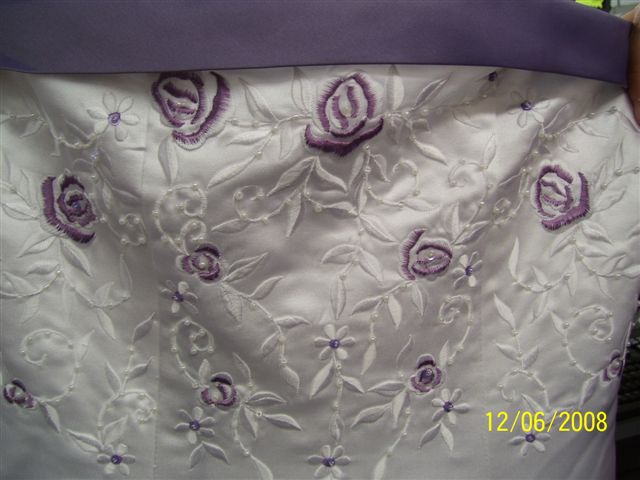 white dress trimmed with victorian lilac