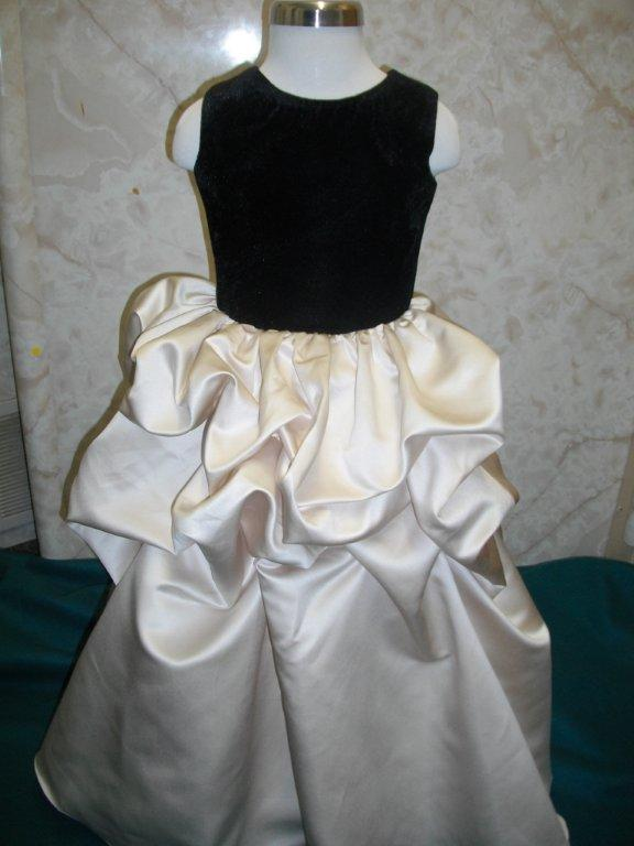champagne ruched dress with black velvet bodice and matching 3/4 sleeve jacket