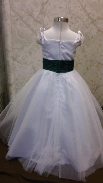 white dress with green sash