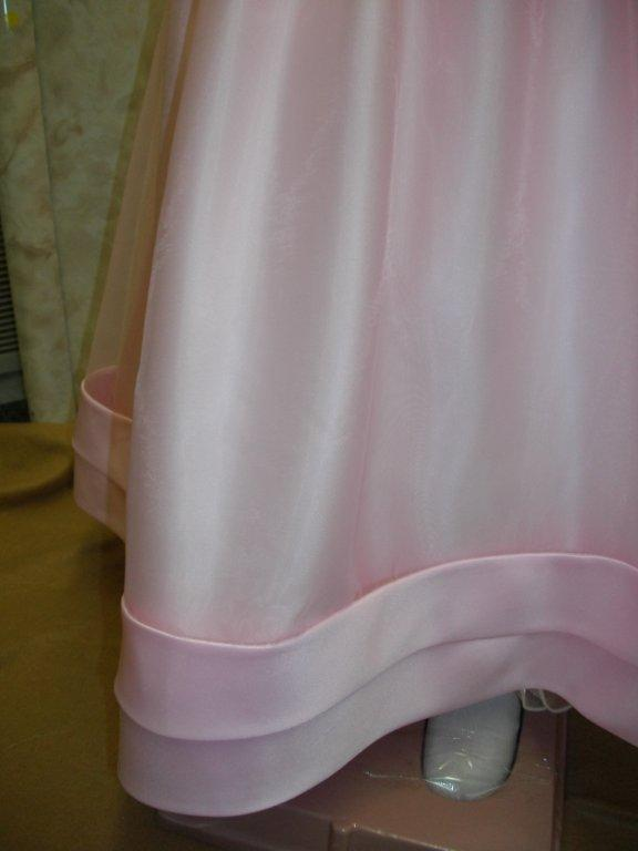 Organza skirt is gathered to create fullness