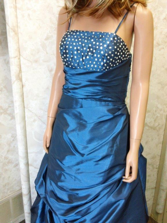 Ocean Blue prom dress has an intricate beaded bodice