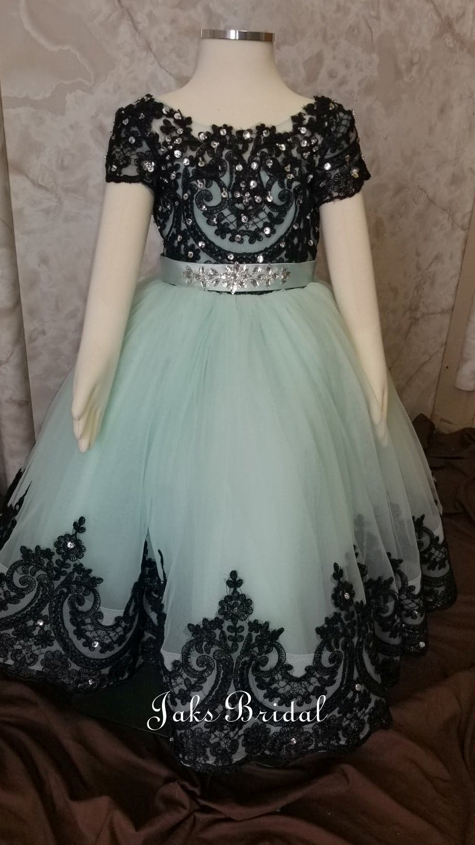 mint green and black ball gown