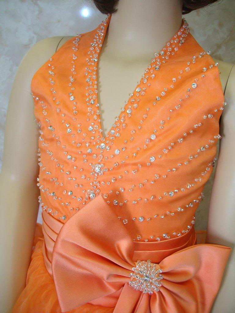 orange halter pageant dress with side bow