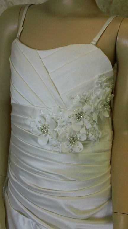 ruched bodice with beaded flower detail