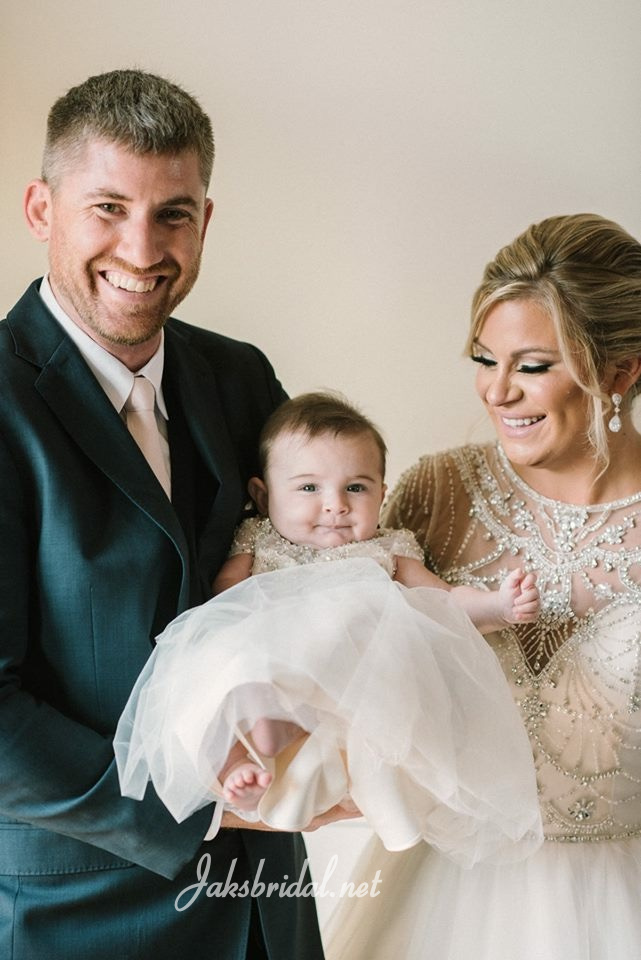 bride and groom with baby daughter