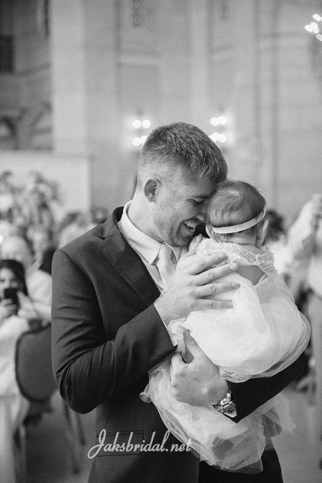 groom and baby daughter