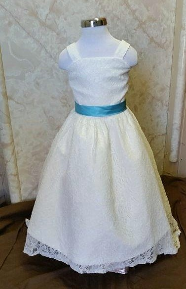 ivory lace dresses with pool blue sash