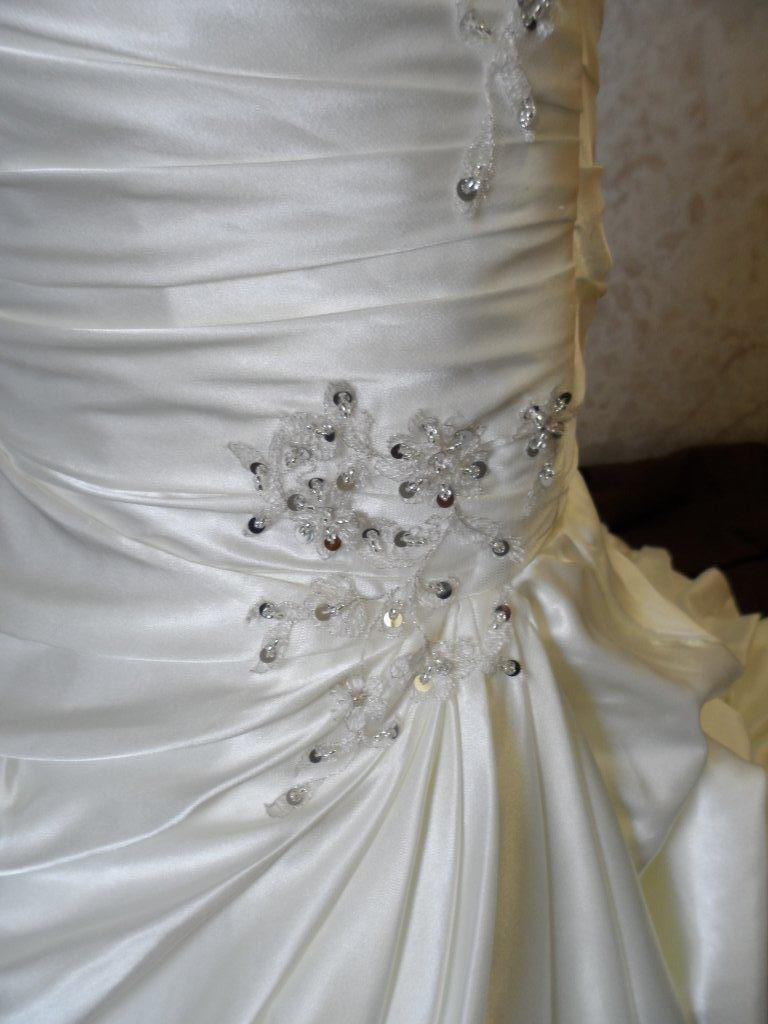 beaded pickup appliques on bubble layered miniature bridal gown