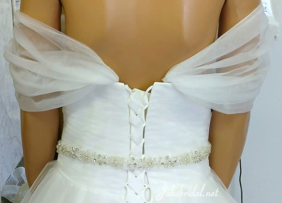Off shoulder wedding gown with corset back