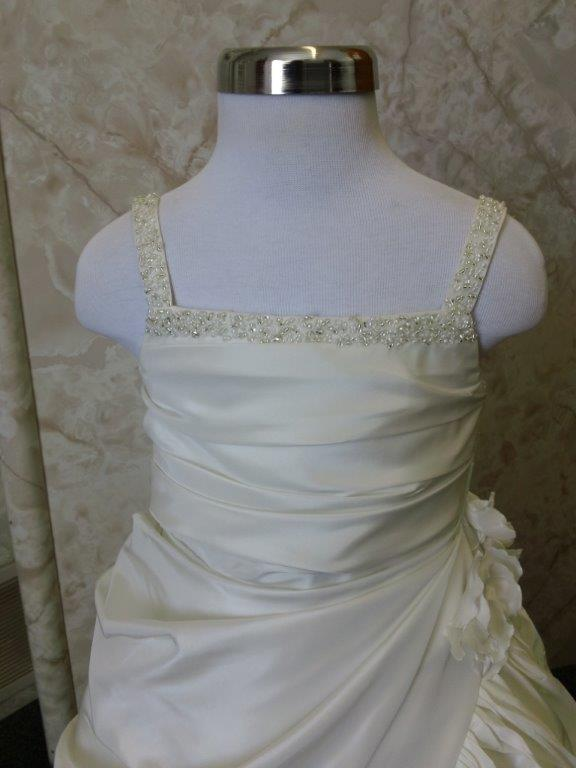 champagne gown with beaded straps and ruched bodice