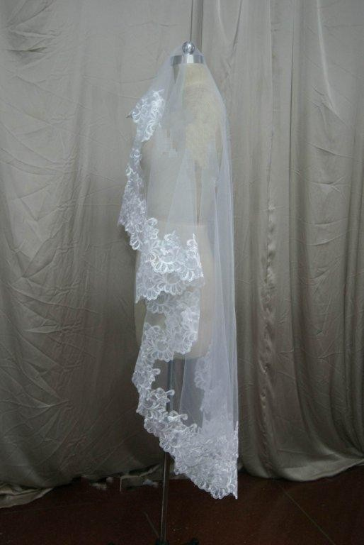 Lace trimmed waltz length bridal veil