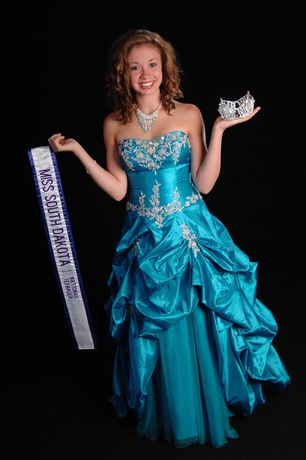 Miss SD Junior National Teenager wearing a mermaid blue strapless pick up evening gown.