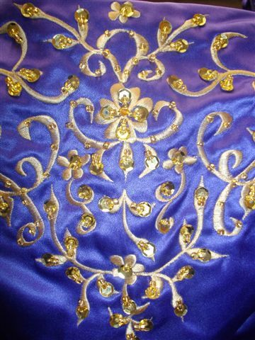 Embroidery and sequins on bodice