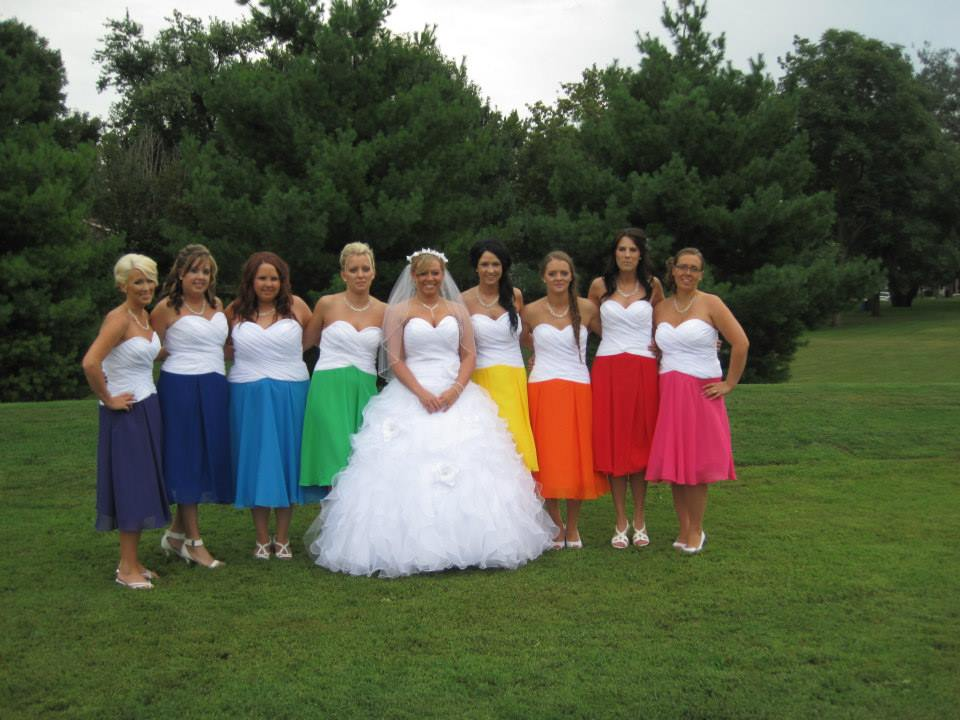 8 bridesmaids in short rainbow colored dresses
