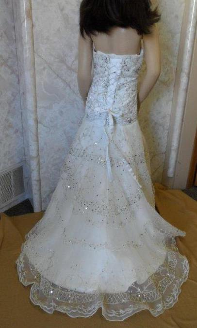 heavy embroidery and beaded miniature wedding gown