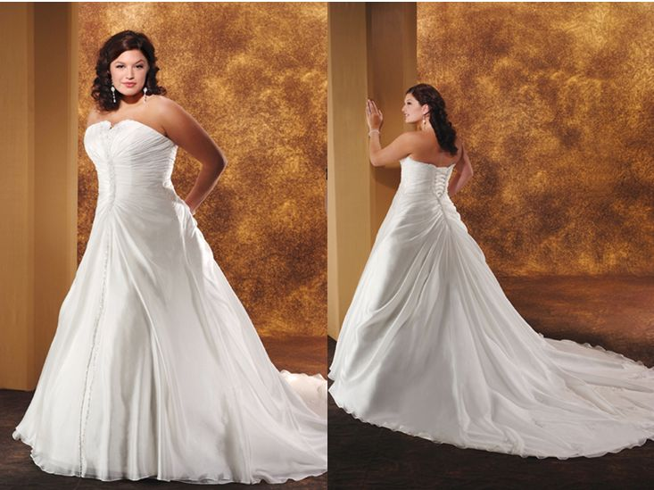 Organza Wedding Gown Featuring A Strapless Neckline With V Shaped Cut Out Along The Shirred Overlay Is D And Cinched Towards Centered