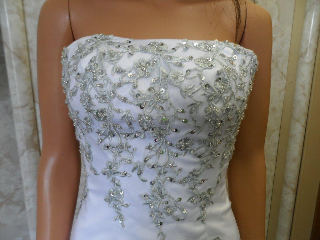 white wedding bodice with chrome lace vines