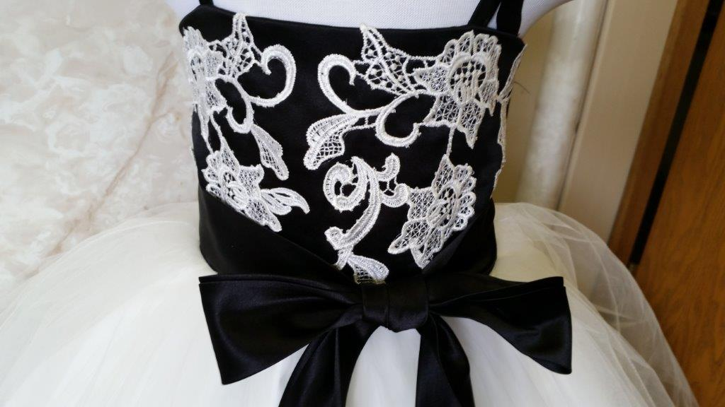 black bodice with ivory lace applique