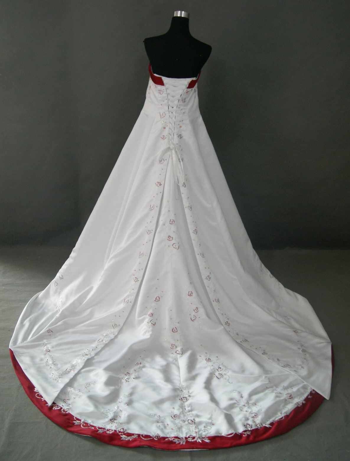 Wedding dress with red embroidered flowers